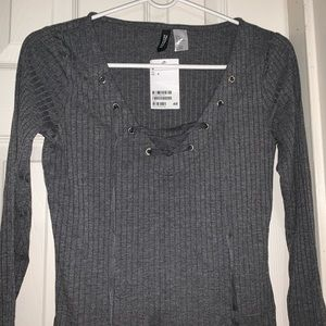Long sleeve grey top , with lace up details